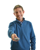 Smiling young man pointing TV remote control