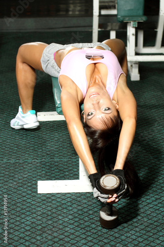 Attractive athletic fitness model doing fitness