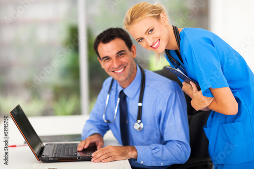 happy medical nurse and doctor in office