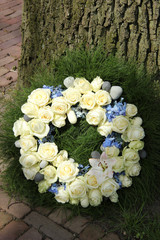 White roses on a sympathy wreath