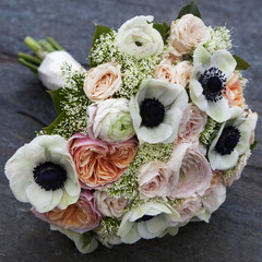 Wedding bouquet of pink roses, white anemone, pink ranunculus