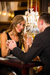happy couple have a romantic date in restaurant