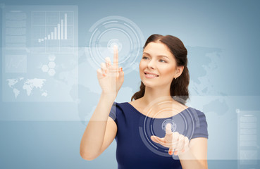 businesswoman touching virtual screen
