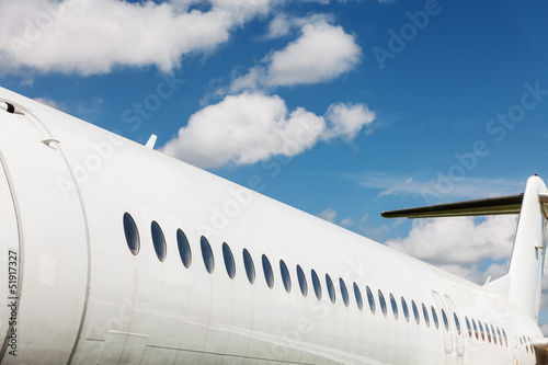Windows and fuselage of a private airplane with tail section