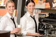 Cheerful waitresses serving hot coffee in bar