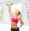 woman lifting steel dumbbell