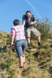 Man Helping His Girlfriend Hiking