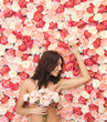 woman and background full of roses