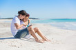 Young Couple at Seaside with Digital Tablet