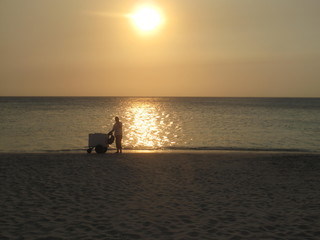Silhouette of Ice Cream Cart and Vendor on Beach, Honduras