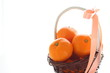 Mandarin orange in bamboo basket on white background,