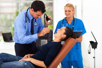 woman having throat examination