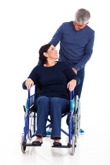 mature man talking to disabled wife
