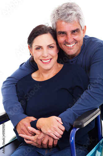 loving supportive husband hugging disabled wife