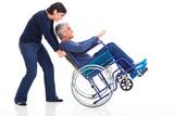 mature couple having fun with wheelchair