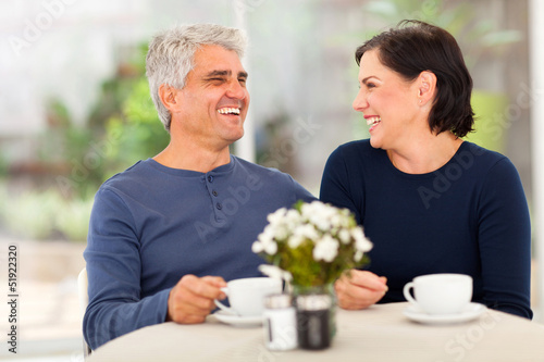 happy middle aged couple enjoying tea