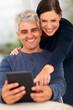 senior couple using tablet computer