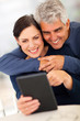 mature couple using tablet computer