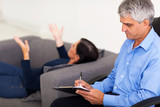 middle aged therapist consulting patient