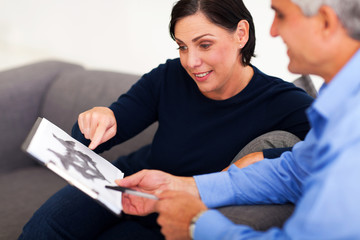 mature female patient looking at Rorschach inkblot with psycholo