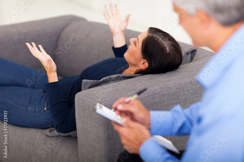 middle aged woman talking to psychologist