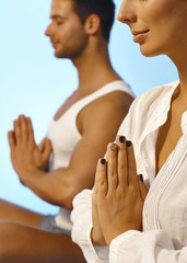 Closeup photo of meditating people