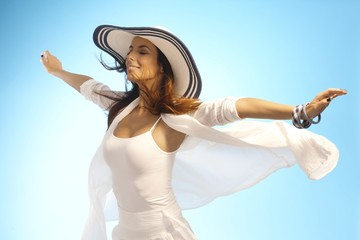 Attractive woman in sun and wind