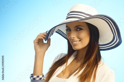 Closeup portrait of elegant woman in straw hat