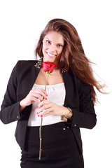 Smiling woman in suit holds red rose isolated on white