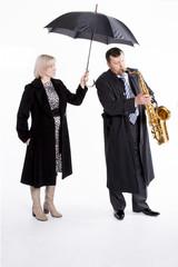 Saxophonist under an umbrella