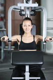 The girl is engaged in the gym doing exercise strengthens chest poster