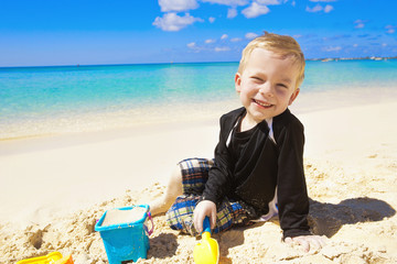 Little Boy Playing in the Sand on Beach