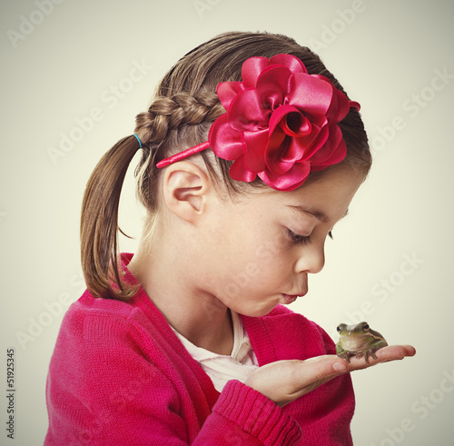 Little Princess kissing a frog