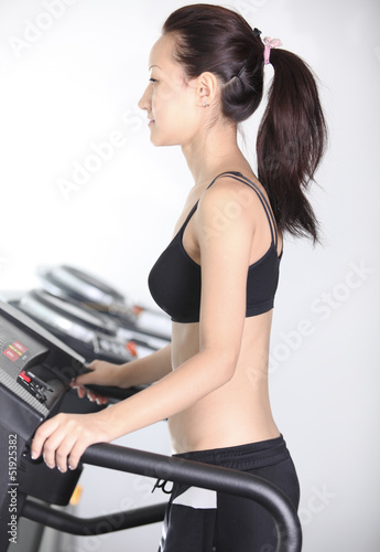 Asian girl slim body likes to run in the simulator