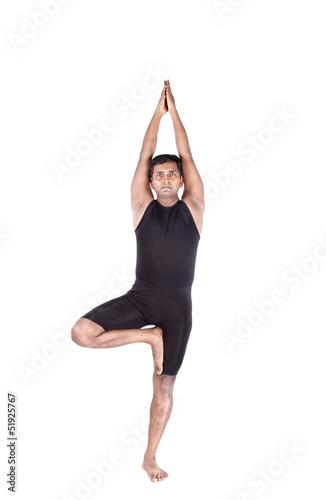 Yoga tree pose on white