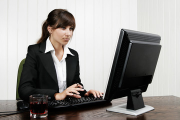 Young woman working with the computer