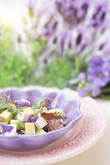 Salad with feta cheese, avocado and violets