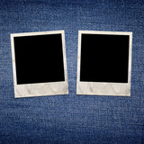 Vintage photo frames on blue jeans background