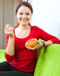 young woman eats grapefruit with spoon