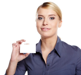 A beautiful woman holds out a business or credit card Isolated o