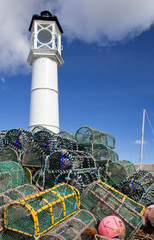 Lobster traps with lighthouse, Kirkwall harbour
