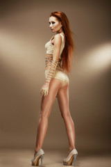 Nightlife. Performance. Red Hair Woman in Beige Stage Costume