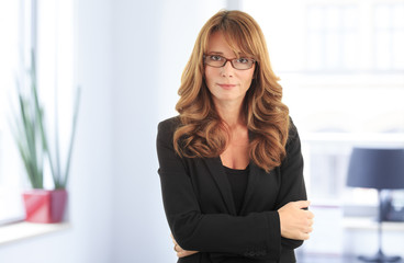 Pretty mature business woman smiling confidently in office