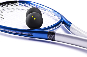 Blue and silver squash racket and balls