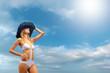 Bikini model over sky background