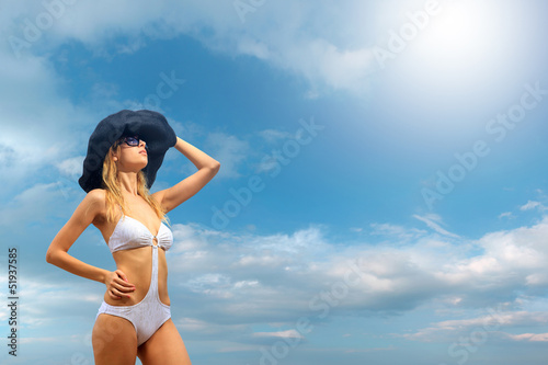 Bikini model over sky background