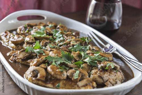 Platter of Chicken Marsala with glass of wine
