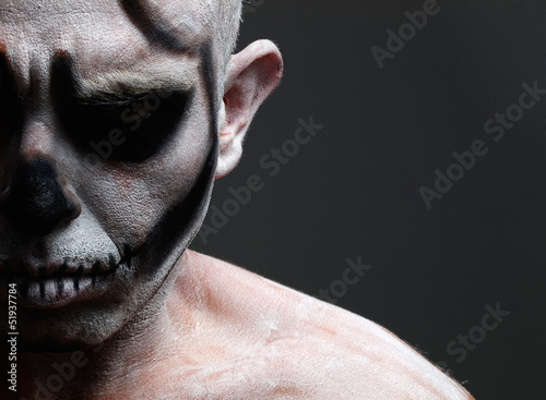 Man with his face painted with a skull