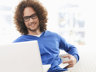 Young man paying with a credit card online