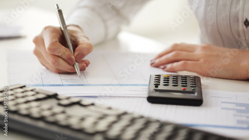 accountant making calculations and taking notes